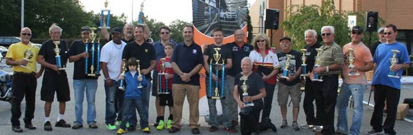 Bergen Knights Chapter President Tassos Nicholson (left of center) and Car Show chairmen Brother Joe Spaccavento (right of center) with the 2014 Bergen Knights Car Show trophy winners.