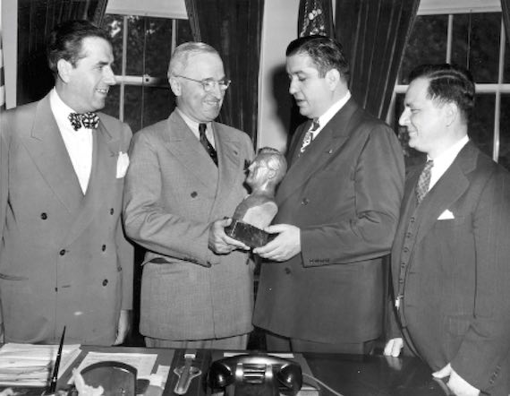 1948 - President Harry S. Truman (second from left) is presented with a bust of the late President Franklin D. Roosevelt by members of the Order of Ahepa. A larger version of the bust will be erected at the Roosevelt home at Hyde Park, New York. Those present are John G. Carzio, Harris J. Booras, and Achilles Catsonis