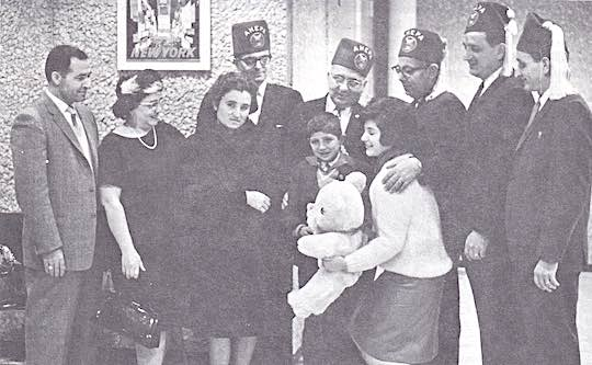 1964 - Ahepa District #13 heart patient from Greece with his parents and Ahepa Heart committee
