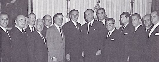 1964 - WHITE HOUSE VISIT. With President Lyndon B. Johnson: William G. Poulos, Nicholas Liaskos, G. William Holmes, George S. Stratigos, Kim.on A. Doukas. Gus G. County, Jr., Mike Manatos (Administrative Assistant to President Johnson), Nicholas J. Chirekos, President Johnson, Peter H. Cardiges, Socrates V. Sekles, Gus Cherevas, Charles M. Georgeson, George T. Poolitsan, Andy Panos.