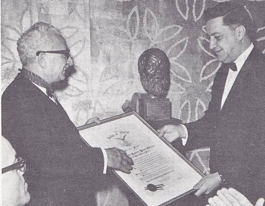 1966 - PRESIDENT LYNDON B. JOHNSON was the recipient of the 1966 award, received in his behalf by his Administrative Assistant, Mike N. Manatos (right). Supreme President Kimon A. Doukas makes the presentation
