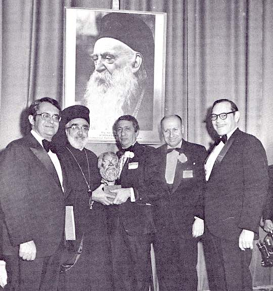 <p>Posing before an enlarged photo of His Holiness Patriarch Athenagoras I, Ecumenical Patriarch, who was the recipient of the 1972 Ahepa Socratic Award are (left to right): U. S. Secretary of Commerce Peter G. Peterson, His Eminence Archbishop Iakovos and Supreme President Sam Nakis holding the Socratic Award bust, His Excellency Dimitrios Tsakonas, Foreign Undersecretary of Greece, and U. S. Senator Robert Taft, Jr.
