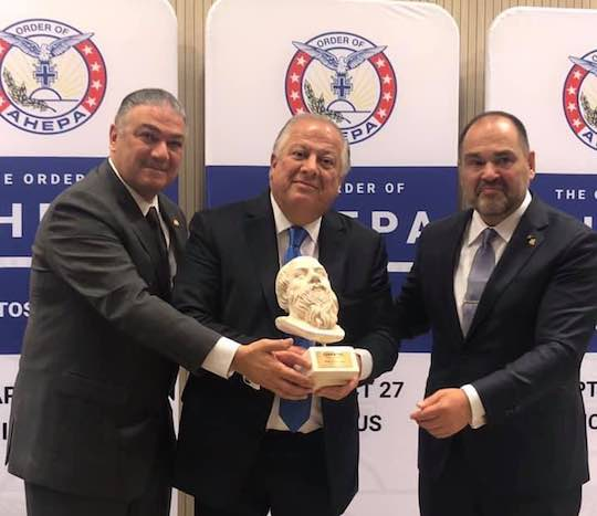 2019 - Supreme President George E. Loucas and Chairman of the Board Nicholas A. Karacostas, PSP, present the 2019 AHEPA Socrates Award to Philip Christopher